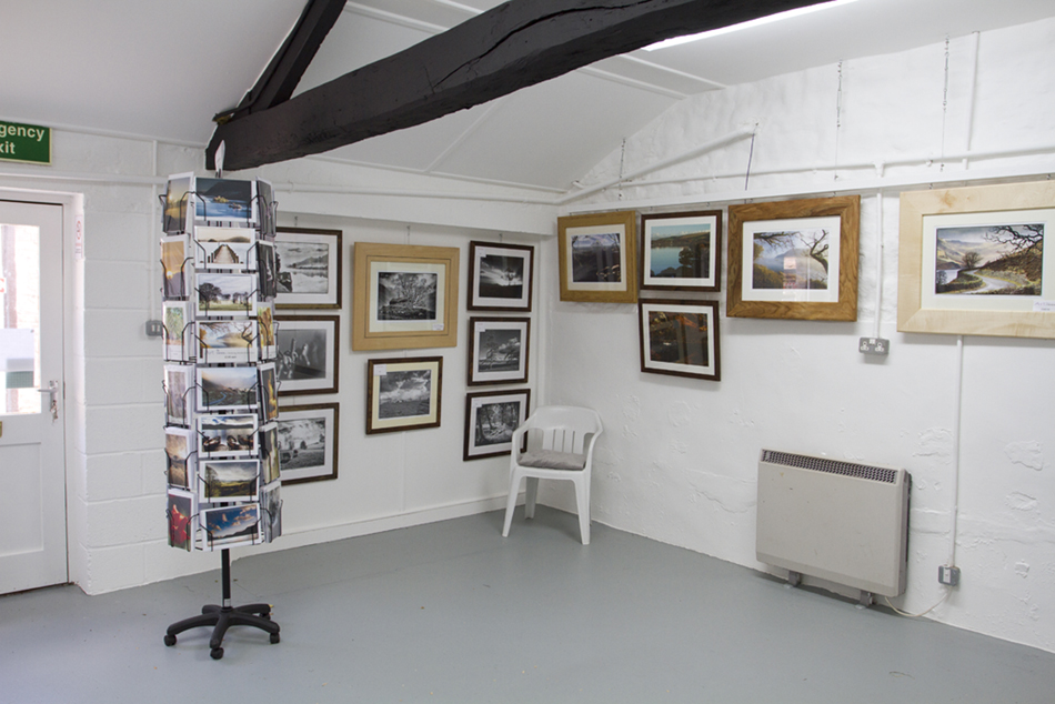 A photograph of a corner of our studio showing some of our framed images.